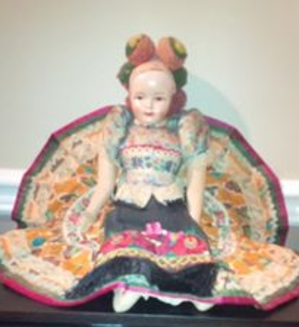 hungarian doll with embroidery and pom-pom hat